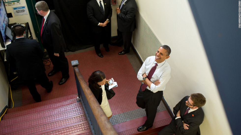 Obama holds backstage with Nancy-Ann DeParle, Deputy Chief of Staff for Policy, and traveling aide Bobby Schmuck prior to an event at the Elm Street Middle School in Nashua, New Hampshire, on Oct. 27, 2012.