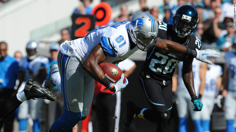 Wide receiver Calvin Johnson of the Detroit Lions grabs a midfield pass against the Jacksonville Jaguars on Sunday, November 4, at EverBank Field in Jacksonville, Florida.