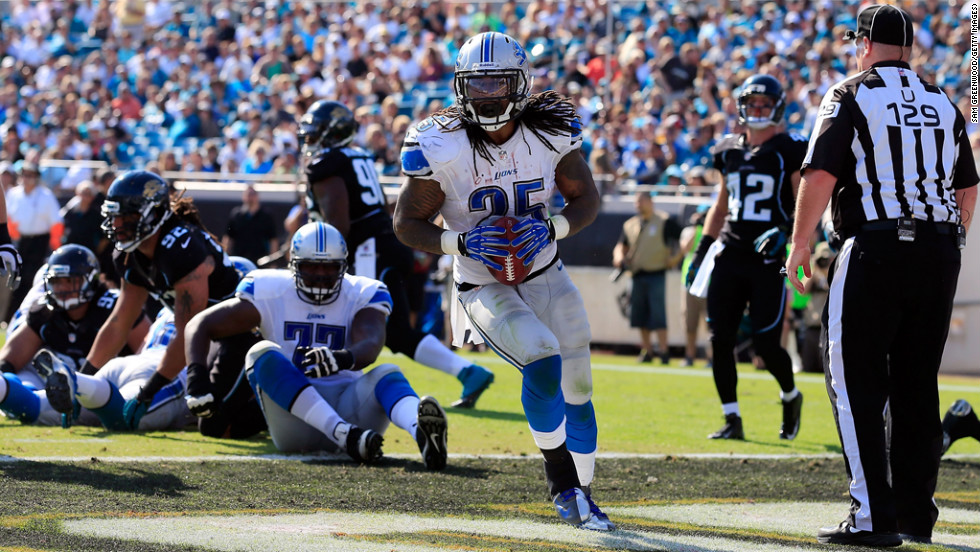 Mikel Leshoure of the Lions scores a touchdown during the game against the Jaguars on Sunday.
