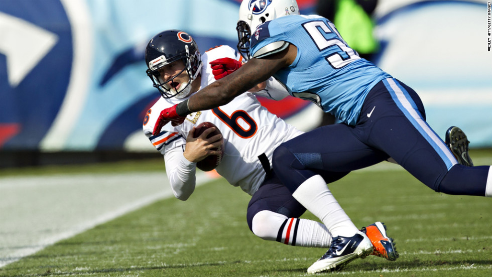 Jay Cutler of the Bears is tackled by Akeem Ayers of the Titans on Sunday.