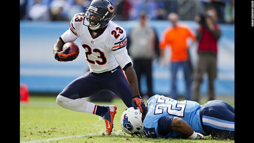 Devin Hester of the Bears is tackled by Jamie Harper of the Titans on Sunday.