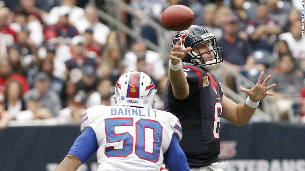 Texans quarterback Matt Schaub completes a pass while being pressured by Bills linebacker Nick Barnett.