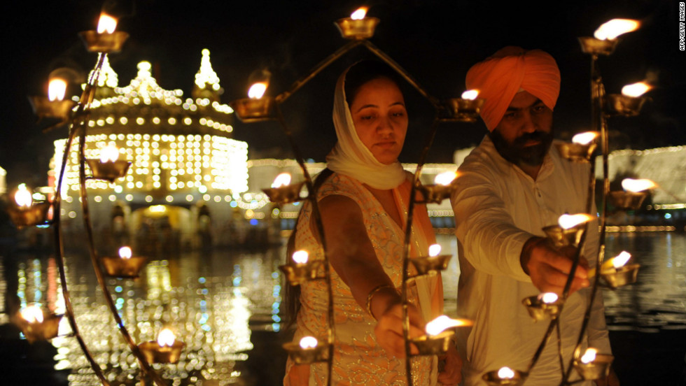 Diwali is not only celebrated by Hindus, it is also an occasion for celebration by Jains and Sikhs (pictured). The Sikhs celebrate Diwali to mark the return of the Sixth Guru, Guru Hargobind Ji, who was freed from imprisonment and also managed to release 52 political prisoners at the same time from Gwalior fort by Mughal Emperor Jahangir in 1619.