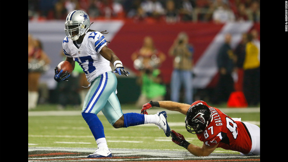 Dwayne Harris of the Cowboys returns a punt past Tommy Gallarda of the Falcons.