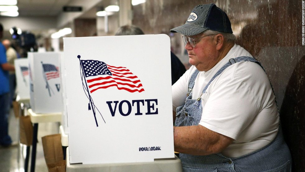 Jerry Nagel fills in his ballot during early voting at the Black Hawk County Courthouse in Waterloo, Iowa, on September 27, the first day of early voting in the state.