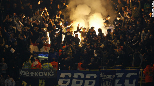 Dinamo Zagreb fans light flares during a match against Tottenham Hotspur at White Hart Lane in London on November 6, 2008.