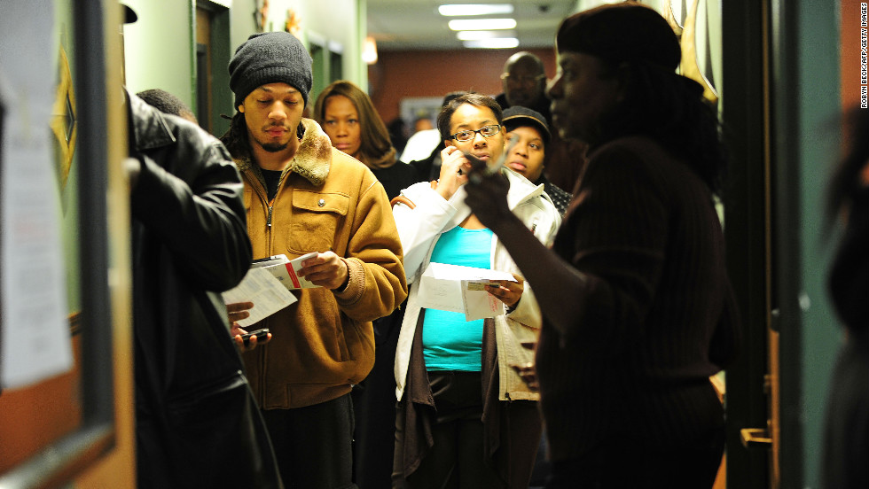 Citizens wait in line at a polling station in a senior appartment complex in Chicago.