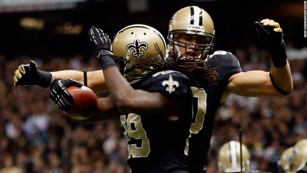 Chris Ivory, left, and  Jimmy Graham of the Saints celebrate after Ivory scored a touchdown against the Eagles on Monday.