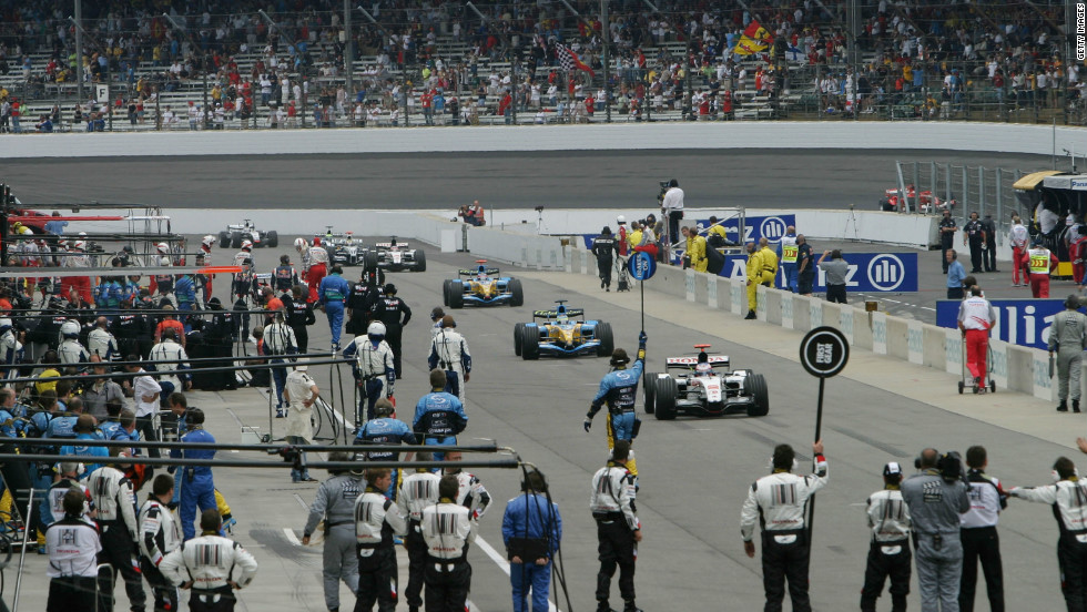 At the end of the parade lap, the seven Michelin teams peeled off into the pit lane -- leaving only Ferrari, Jordan and Minardi to contest the race.