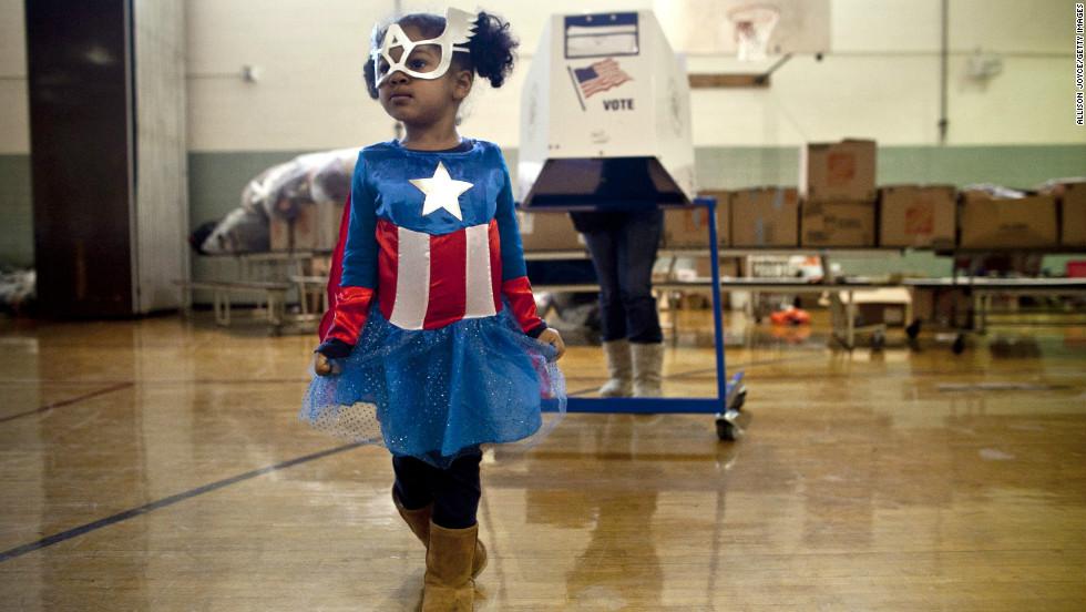 Raena Lamont, 3, wore a Captain America costume at a polling center Tuesday in Staten Island, New York.