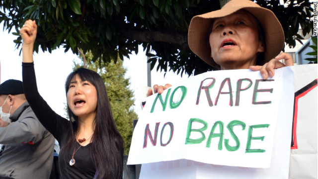Civic groups in Tokyo protest the alleged rape of a Japanese woman by two U.S. servicemen on October 20.