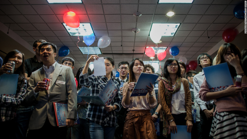 Students monitor a live broadcast about the election Wednesday at the U.S. Consulate in Hong Kong.