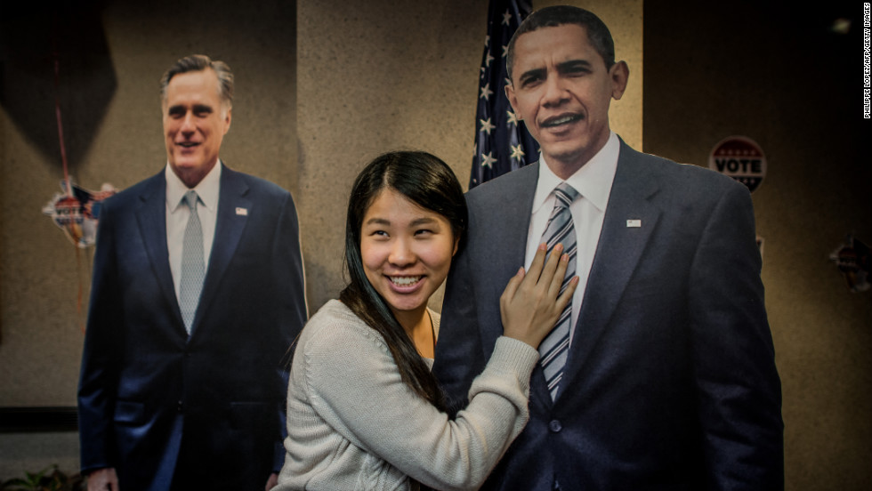 A student poses with a cutout of Obama on Wednesday at the U.S. Consulate in Hong Kong.