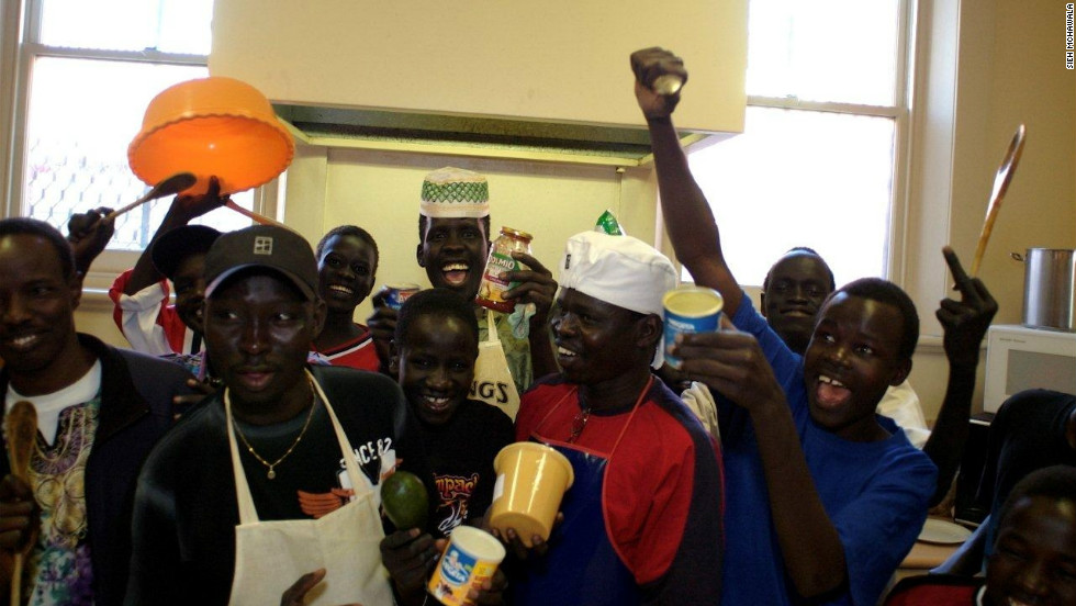 Sudanese refugee men in Adelaide, Australia, celebrate cooking their first meal for their community's female elders.