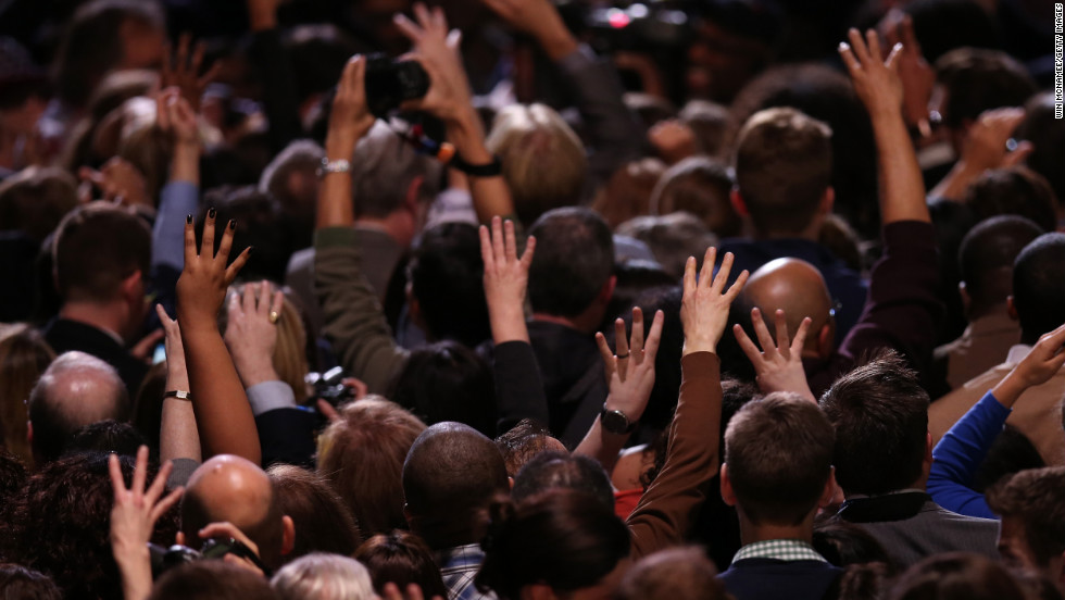 Obama supporters raised their hands in victory at an election night watch party in Chicago.
