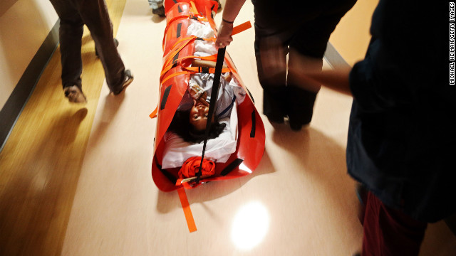 Workers at NYU Langone Medical Center evacuate patient Deborah Dadlani as Superstorm Sandy bears down on the city.