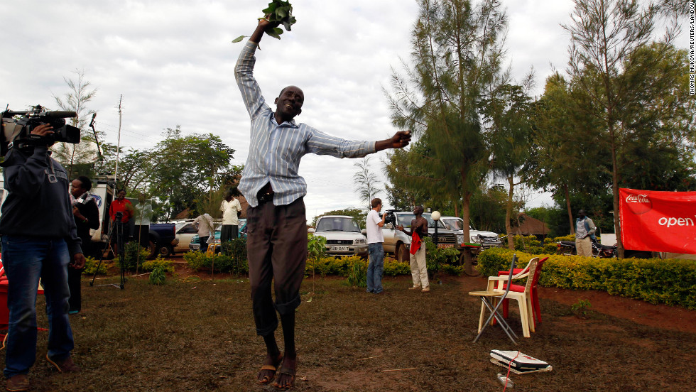 A man jumps for joy as he celebrates President Obama's re-election in the president's ancestral village of Nyangoma Kogelo, Kenya.
