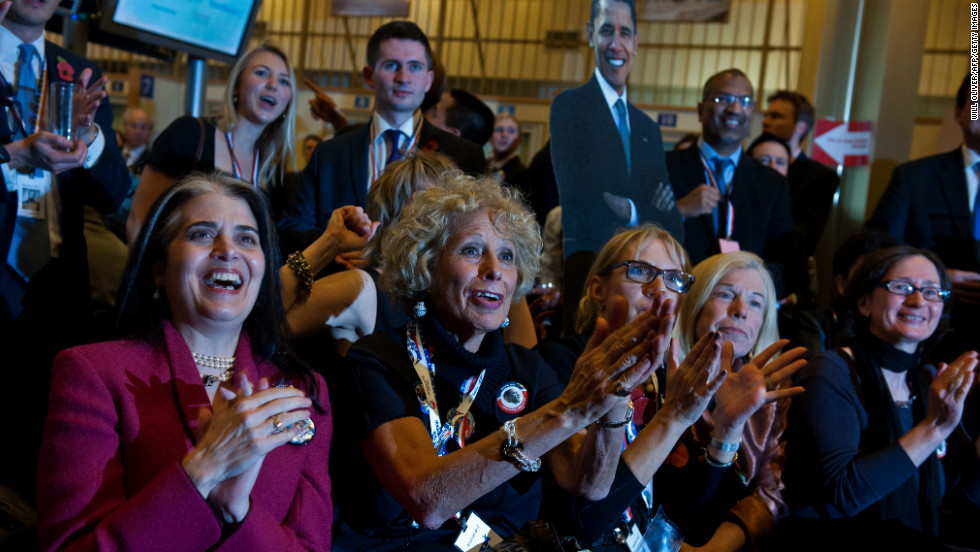 Obama supporters react as they watch a television screen during an election viewing party at the U.S. Embassy in London, England.