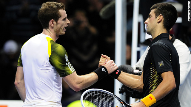 Andy Murray, left, congratulates Novak Djokovic after Djokovic the Serbian won their Group A  match on day three of the ATP World Tour Finals in London.