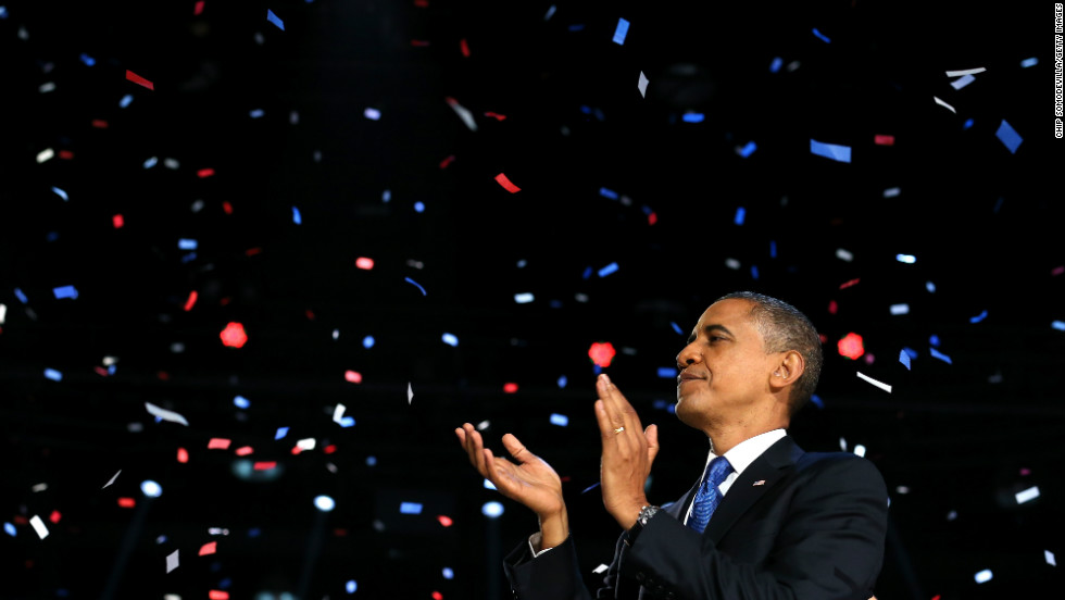 Red, white and blue confetti snowed down on President Barack Obama after a victory speech that promised brighter days ahead.