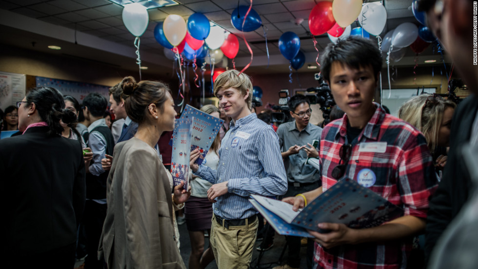 Students chat during an Election Day party at the U.S. consulate in Hong Kong on Wednesday.