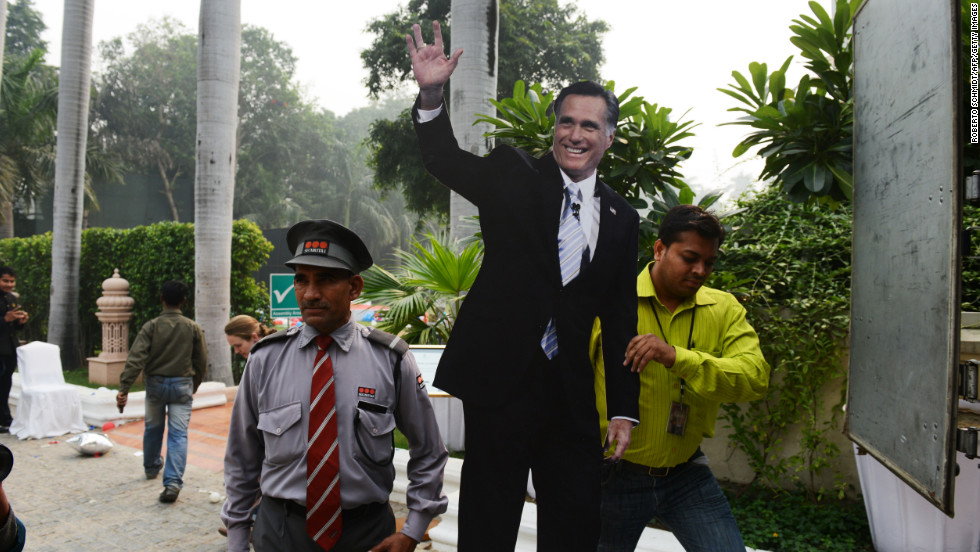 A cutout of U.S. presidential candidate Mitt Romney is carried away by a catering company worker after a U.S. embassy election party at a local hotel in Delhi on Wednesday.