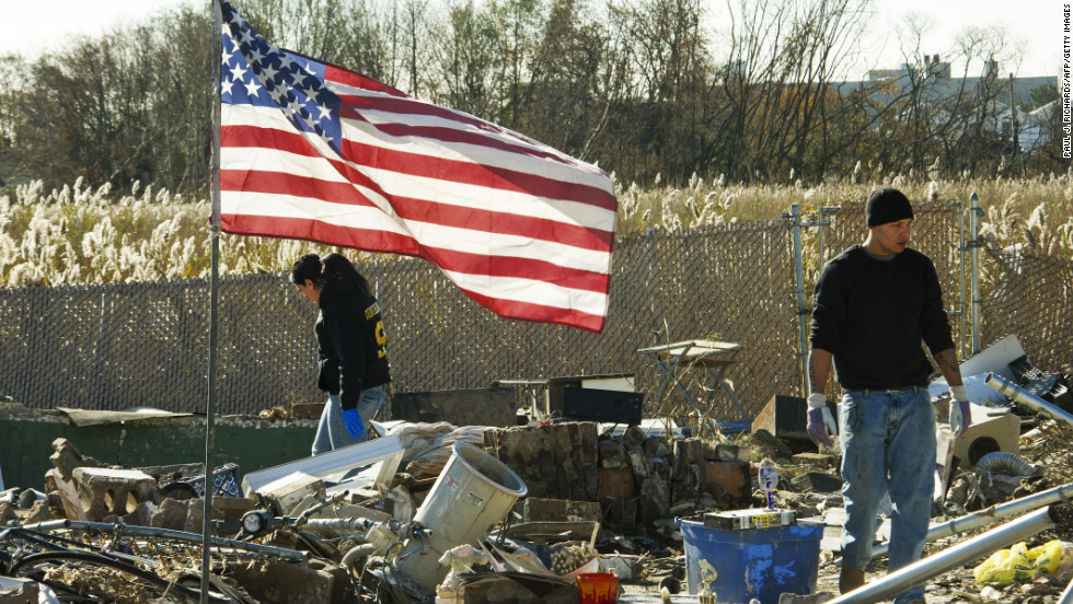 "Friends and members of the Puglia family sift through the remains of their missing home for valuables on November 6, 2012, after Hurricane Sandy hit Staten Island, New York.  <a href=""http://www.cnn.com/2012/10/29/us/gallery/ny-braces-sandy/index.html"">View photos of New York preparing for Sandy.</a>"