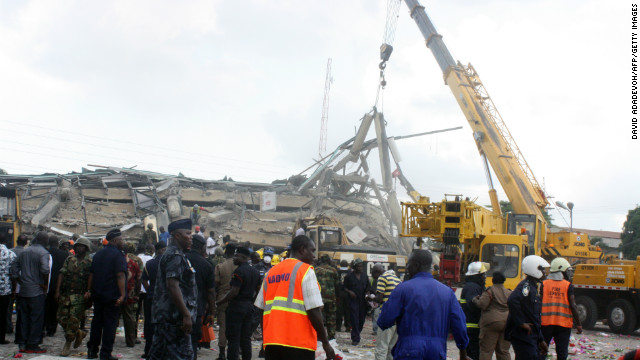 An excavator clears the remains of a shopping centre that collapsed on November 7, 2012 in Accra, killing at least three people.