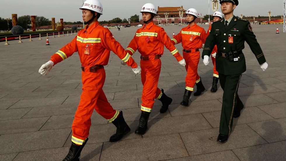 Chinese paramilitary policemen march through Tiananmen Square on November 7.