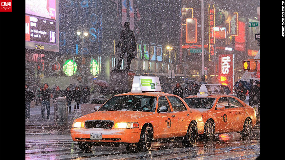 "Cabs and pedestrians navigate the snow from a nor'easter falling in Manhattan on Wednesdayin this photo taken by<a href=""http://ireport.cnn.com/docs/DOC-877979"" target=""_blank""> CNN iReporter Edgar Alan Zeta Yap</a>."