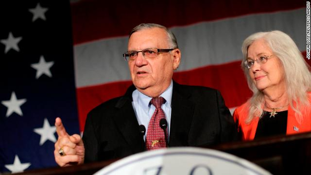 Maricopa County Sheriff Joe Arpaio speaks next to his wife, Ava Arpaio, on Tuesday night in Phoenix,  Arizona.