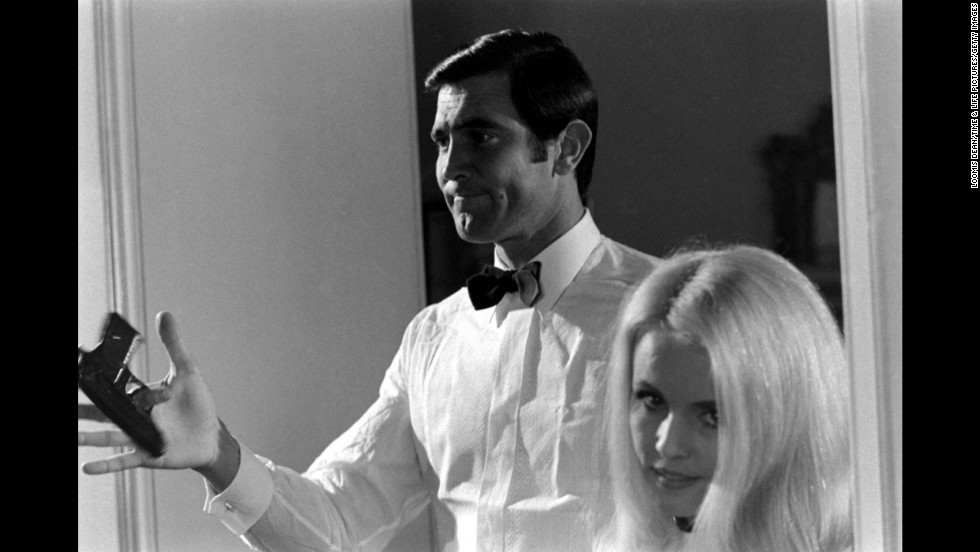 """Lazenby twirls a gun beside potential Bond Girl Marie-France Boyer. <a href=""""http://life.time.com/culture/being-007-behind-the-scenes-at-james-bond-auditions/?iid=lf