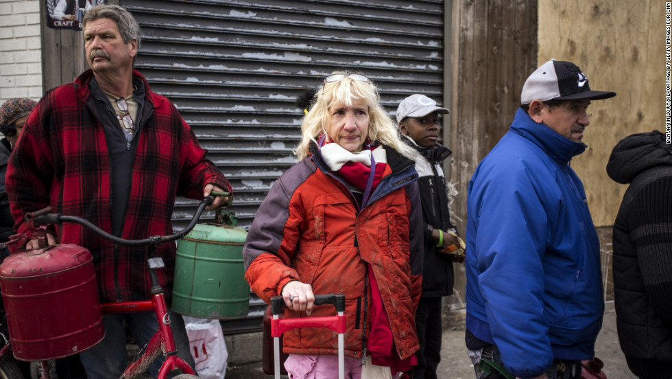 Anne Wyley, 55, waits in line for gas in Far Rockaway, Queens, where she had major damage to her home and remains without power.