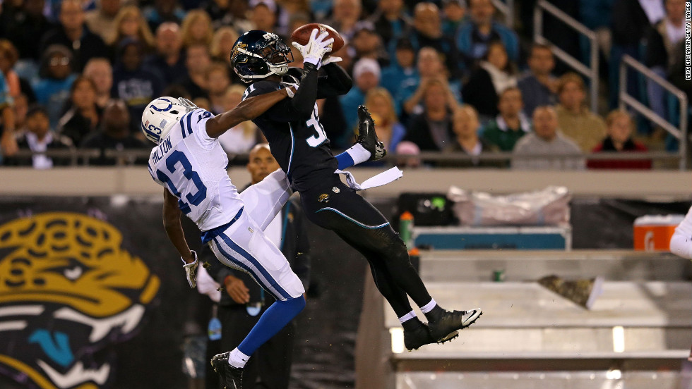 Aaron Ross of the Jacksonville Jaguars goes up for an interception against T.Y. Hilton of the Indianapolis Colts on Thursday, November 8, at EverBank Field in Jacksonville, Florida.