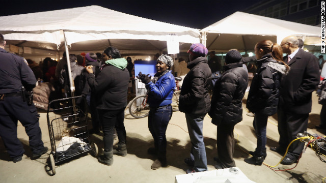 Voters wait at a makeshift polling place in the hurricane-devastated Rockaway neighborhood of Queens, New York.