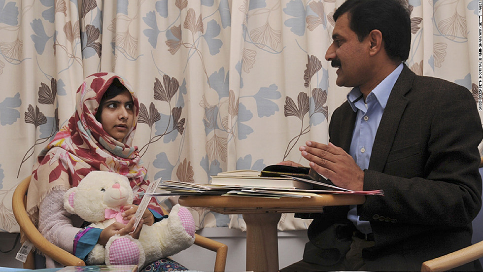 Malala talks with her father, Ziauddin. She was attacked for advocating for girls' education in Pakistan.
