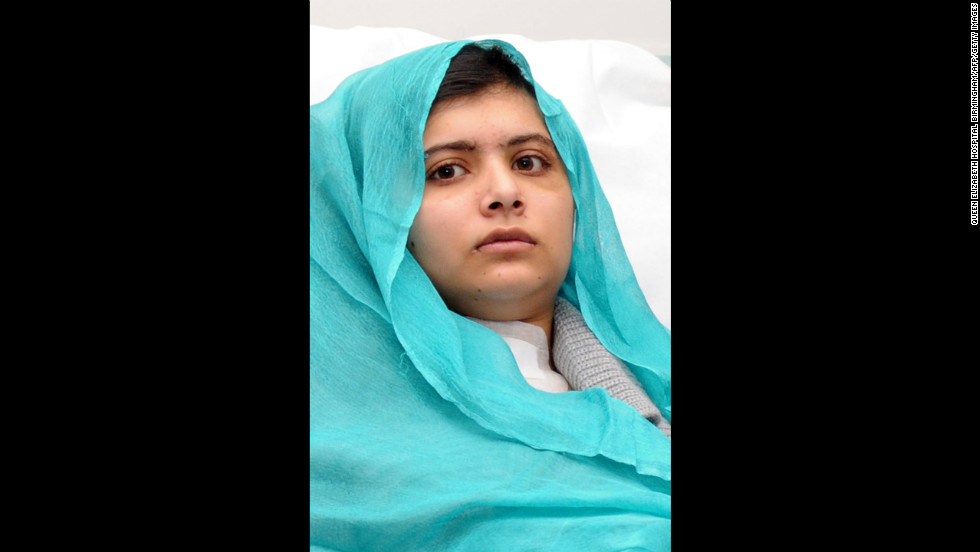Malala sits up in bed on October 25, 2012 after surgery for a gunshot wound to the head.
