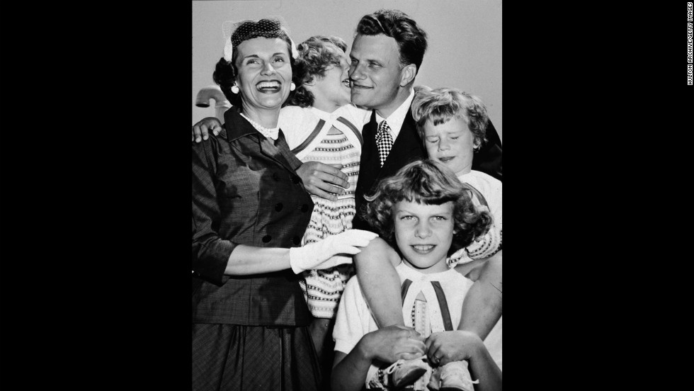 "Graham embraces his family upon his return from his ""Crusade for Christ"" tour in the 1950s. Clockwise from left: wife Ruth, daughter Anne, Graham, daughter Ruth (Bunny), and daughter Virginia."