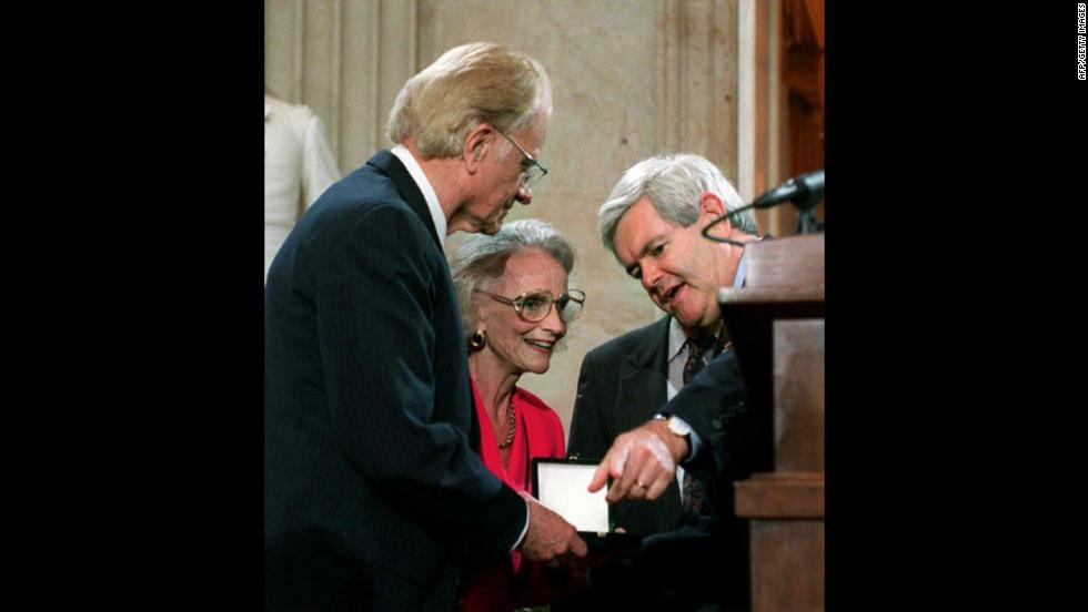 On May 2, 1996, U.S. Speaker of the House Newt Gingrich presents Graham with a Congressional Gold Medal during a ceremony on Capitol Hill as Ruth Graham watches.