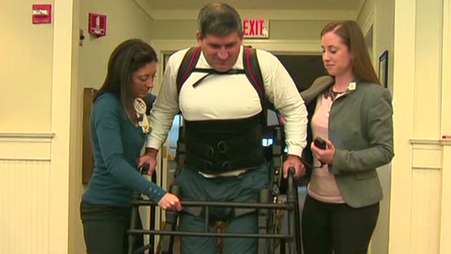 Paralyzed man walks using exoskeleton