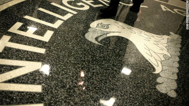 CLEAN, VA - FEBRUARY 19: A man walks across the seal of the Central Intelligence Agency at the lobby of the Original Headquarters Building at the CIA headquarters February 19, 2009 in McLean, Virginia. (Photo by Alex Wong/Getty Images)