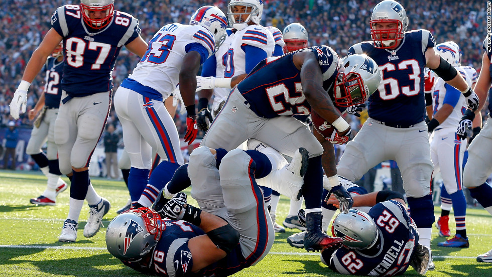 No. 22 Stevan Ridley of the New England Patriots runs the ball into the end zone for a touchdown in the first half on Sunday against the Buffalo Bills at Gillette Stadium in Foxboro, Massachusetts.