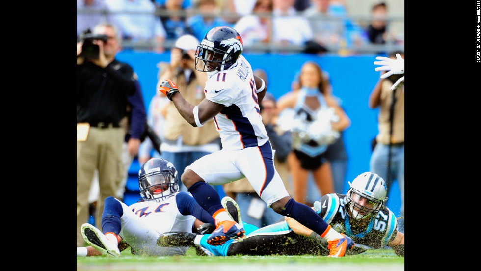 Trindon Holliday of the Denver Broncos breaks away from Jordan Senn of the Carolina Panthers as he takes a punt return back for a touchdown at Bank of America Stadium on Sunday in Charlotte, North Carolina.