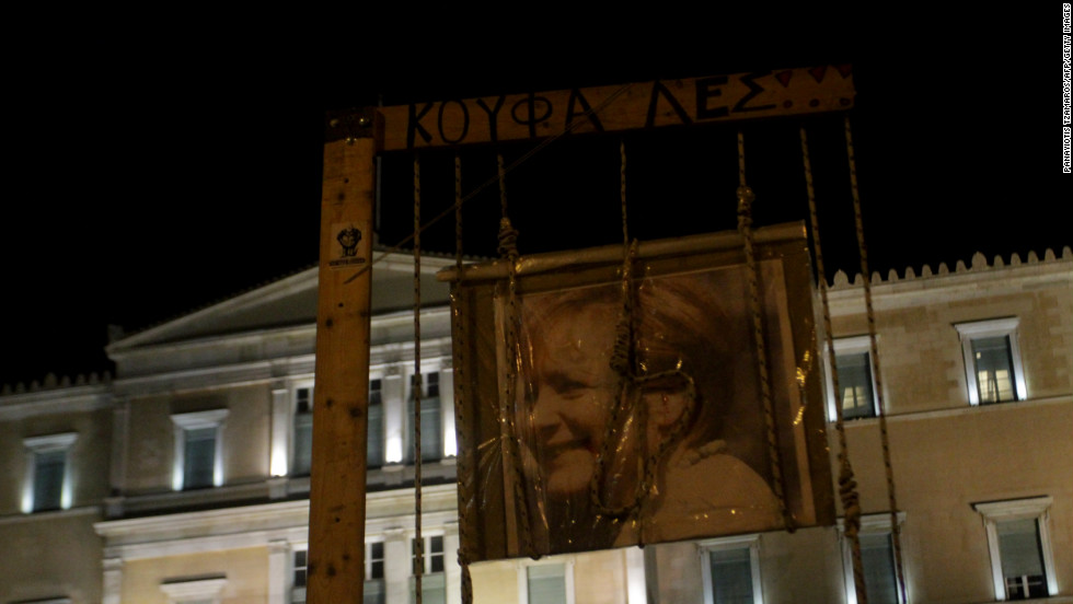 A portrait of German Chancellor Angela Merkel is roped and hung outside the Greek Parliament during a protest against austerity measures in Athens on November 11, 2012.