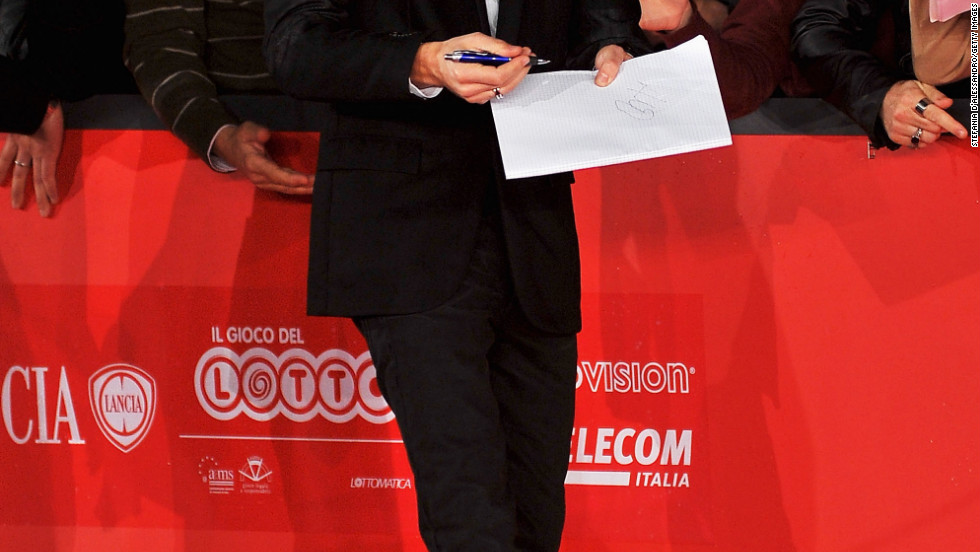 "Adrien Brody signs autographs at the ""Back To 1942"" premiere in Rome."