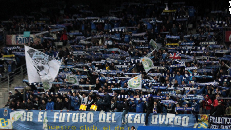"Real Oviedo fans show their support for the club in the Estadio Carlos Tartiere with a banner reading ""For the future of Real Oviedo"" before a game with Real Madrid's reserve team on November 11, 2012."