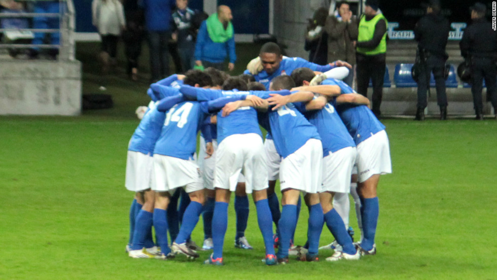 The Oviedo players huddle on the pitch before the match. Just over a decade ago Oviedo  were playing in La Liga alongside Real Madrid and Barcelona, but mismanagement from the club's directors took the Asturian team to the brink of bankruptcy in recent years.