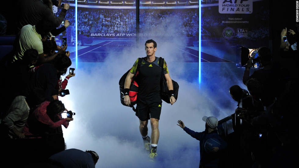 Local hero: Andy Murray walks out before an expectant crowd at the O2 Arena in London.