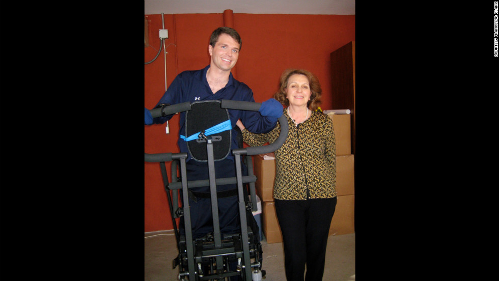 Clark, with his mother, Mariella Spaggiari Clark, completes five hours of physical therapy a week. He lifts weights in his garage.