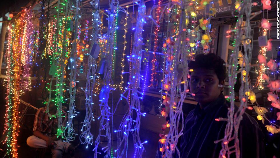 A lighting vendor waits for customers in Siliguri, India, on Sunday, November 11.